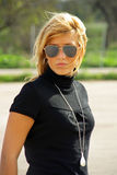 Young Blonde Girl. With sunglasses stock images