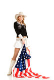 Young blonde girl with american flag Stock Photos