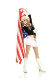 Young blonde girl with american flag Royalty Free Stock Photography