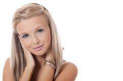 The young blonde girl with beautiful hair Stock Photography