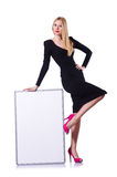 Young blonde girl in black dress with poster Royalty Free Stock Photo