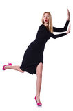 Young blonde girl in black dress pushing Stock Photography