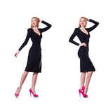 The young blonde girl in black dress showing isolated on white Stock Images