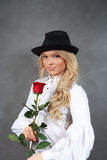 Young blonde girl in a black hat with a Stock Images
