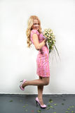 Young blonde girl with a bouquet of flow Stock Photo