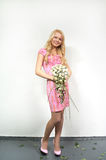 Young blonde girl with a bouquet of flow Stock Photos