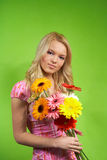 Young blonde girl with a bouquet of flow Royalty Free Stock Photos