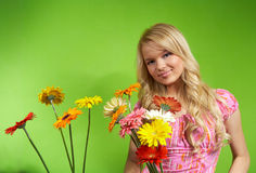 Young blonde girl with a bouquet of flow Royalty Free Stock Photo