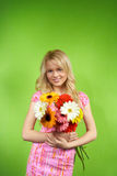 Young blonde girl with a bouquet of flow Stock Image