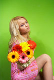Young blonde girl with a bouquet of flow Royalty Free Stock Photography
