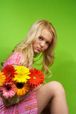 Young blonde girl with a bouquet of flow Stock Photography