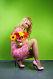 Young blonde girl with a bouquet of flow Stock Images