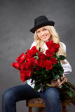 Young blonde girl with a bouquet of rose Royalty Free Stock Photos