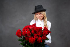 Young blonde girl with a bouquet of rose Royalty Free Stock Photo