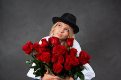 Young blonde girl with a bouquet of rose Royalty Free Stock Images