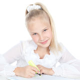 Young blonde girl drawing at the desk Stock Photography