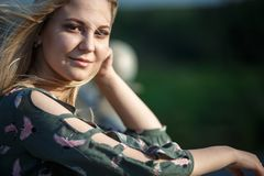 Young blonde girl in the evening soft light of the sun. stock images