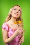 Young blonde girl with flower. Beautiful young blonde girl with flower Stock Images