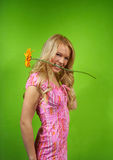 Young blonde girl with flower Stock Images