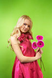 Young blonde girl with flower Stock Image