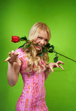 Young blonde girl with flower red rose Stock Photos