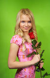 Young blonde girl with flower red rose Royalty Free Stock Photo