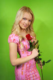 Young blonde girl with flower red rose Stock Images