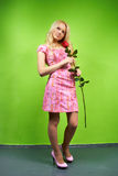 Young blonde girl with flower red rose Stock Image