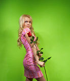 Young blonde girl with flower red rose Royalty Free Stock Image