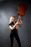 Young blonde girl with a guitar Stock Image