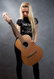 Young blonde girl with a guitar. Beautiful young blonde girl with a guitar Stock Photography