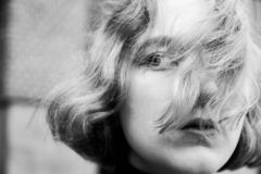 Young blonde girl with hair fluttering in the wind closeup portrait stock photography