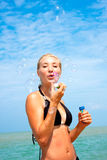 Young blonde girl having fun on the beach Stock Photography