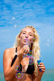 Young blonde girl having fun on the beach Stock Photo