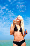 Young blonde girl having fun on the beach Royalty Free Stock Photo