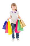 Young blonde girl holding shopping bags Royalty Free Stock Photo