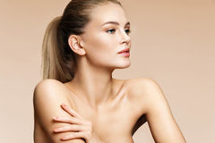 Free Young Blonde Girl In Profile On Beige Background. Royalty Free Stock Photo - 95424435