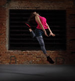 Young blonde girl jumping Royalty Free Stock Photos