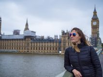 Young blonde girl in London - Westminster Bridge and Houses of Parliament. Travel photography Royalty Free Stock Photo