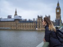Young blonde girl in London - Westminster Bridge and Houses of Parliament. Travel photography Stock Photos