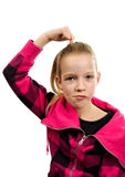 Young blonde girl is looking questionable Royalty Free Stock Photo