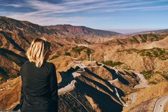 Free Young Blonde Girl Meditates Over The Panorama Of Tizi N Tichka Mountain Pass In Morocco Royalty Free Stock Images - 153987459