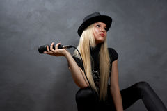 young blonde girl with microphone Stock Photo