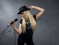 Young blonde girl with microphone Stock Image