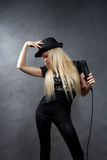 Young blonde girl with microphone Stock Photography