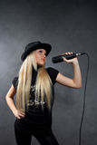 Young blonde girl with microphone Royalty Free Stock Image