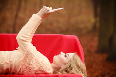 Young blonde girl in park. Royalty Free Stock Photos
