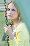 Young blonde girl  at the park Royalty Free Stock Photo