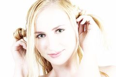 Young blonde girl playing with her hair Stock Images