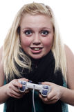 Young blonde girl playing video games Stock Image